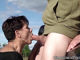 Mature succubus sucks off hung youngster chiefly roadside